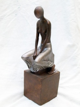 """Woman seated"" - terracotta painted (42 cm)"